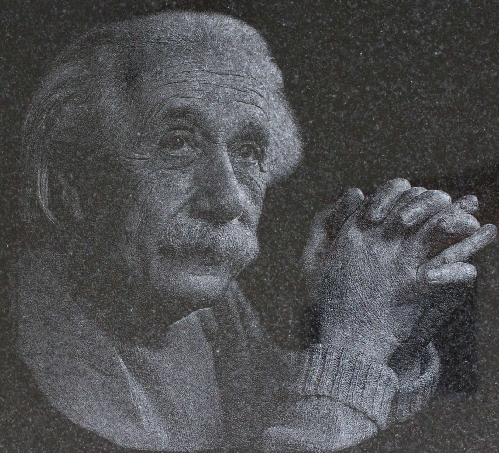 Einstein engraved on black granite.